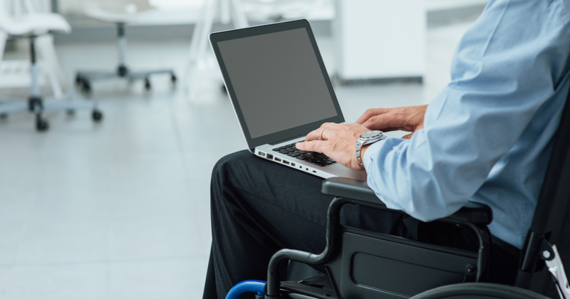 Man in wheelchair and holding laptop: How to Make Your Website Accessible for Everyone: What Small Business Owners Need to Know | Anthony Caliendo | The Sales Assassin